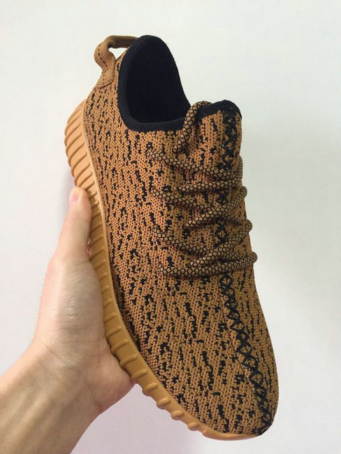 129d8abcdc3bf adidas yeezy boost model of kanye west designed like gold
